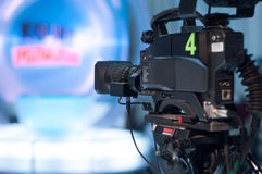 Television studio camera. Video camera lens - recording show in TV studio - focus on camera aperture Royalty Free Stock Photography
