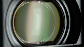 Video camera lens, showing zoom and glare, turns. Black video camera lens, turns and showing zoom and glare, photocamera or videocamera, close up, macro stock footage