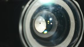 Video camera lens, showing zoom and glare, turns, close up. Video camera lens, showing zoom and glare, turns close up stock footage