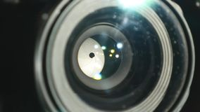 Video camera lens, showing zoom and glare, turns, close up. Video camera lens, showing zoom and glare, turns close up stock video