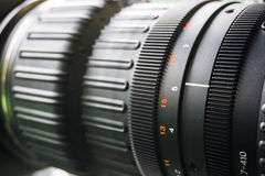 Video camera lens in TV studio - focus on camera aperture Royalty Free Stock Images