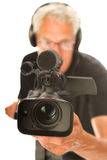 Video camera man. Professional video camera man with focus on objective Royalty Free Stock Photography