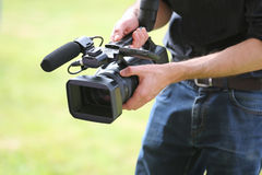 Video camera man with camera Stock Photography