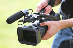 Video camera man with camera. On green background royalty free stock photo