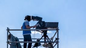 Video camera operator - man working and filming on set with his equipment stock photography