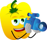 Video camera operator yellow bell pepper Stock Photo