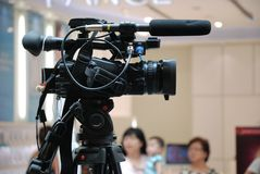 Video Camera. A professional video camera with shotgun directional microphone and live feed accessories stock images