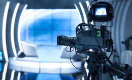 Video camera - recording show in TV studio. Focus on camera Stock Photography