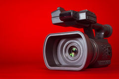 A video camera on a red background