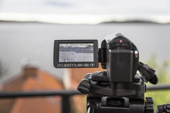 Video camera shoots a landscape with a yacht Stock Photos