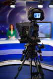 Video camera viewfinder. Video camera lens - recording show in TV studio - focus on camera Royalty Free Stock Images