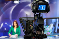 Video camera viewfinder. Recording show in TV studio - focus on camera Royalty Free Stock Image