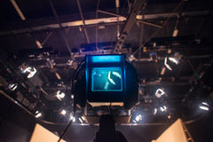 Video camera viewfinder - recording show in TV studio. Focus on camera Stock Photo