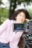 Video camera and woman Royalty Free Stock Images