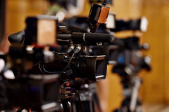 Video cameras at press conference. Several video cameras in a row at a press conference royalty free stock images