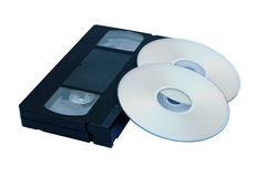 Video cartridge and disk,CD dwd. Video the cartridge and the disk CD dwd on a white background Royalty Free Stock Photo