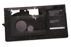 Video cassette adaptor and 16 mm cassette Royalty Free Stock Photography