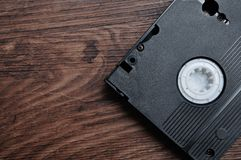 A video cassette. Isolated on a wooden background stock image