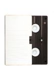 Video cassette tape. VHS video cassette tape in the box with place for text. Isolated on white stock photo