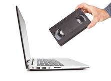 The video cassette technology in the hand compared Royalty Free Stock Photos
