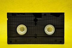 A video cassette. Isolated on a yellow background stock photo
