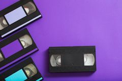Video cassette on violet background. Retro concept royalty free stock image