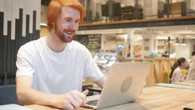 Video chat in cafe on laptop by young man, talking with customers. 4k, high quality stock footage