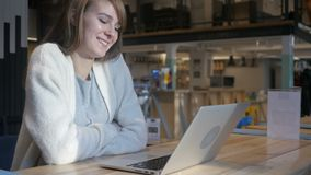 Video Chat in Cafe on Laptop by Young Woman, Busy Talking. 4k , high quality stock video footage