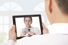 Video chat with doctor Stock Photo