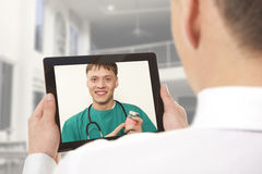 Video chat with doctor Royalty Free Stock Photography