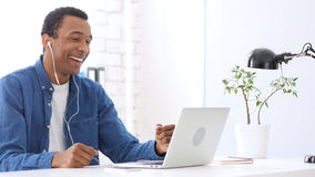Video Chat by Handsome  Afro-American Man. High quality Stock Photo