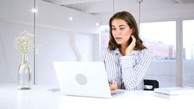 Video chat on laptop by woman sitting in office for work. 4k, high quality stock footage