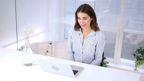 Video chat on laptop, woman talking online in office. 4k, high quality stock video footage