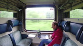 Video Chatting with family during train trip stock video