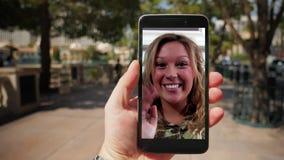 Video Chatting on Smartphone in Las Vegas. Video chatting with a woman on a smartphone while walking in Las Vegas stock video footage
