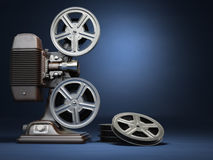 Video, cinema concept. Vintage film movie projector and reels on. Blue background. 3d Royalty Free Stock Photo