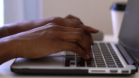 Video clip of diverse woman`s hands typing on keyboard