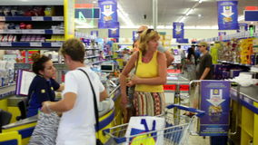 Video clip footage of a Customer paying for shopping at a supermarket stock video