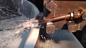 Video clip metal processing with a chisel close-up with coolant flow in slow motion.  stock video footage