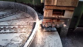 Video clip metal processing with a chisel close-up with coolant flow in slow motion.  stock footage