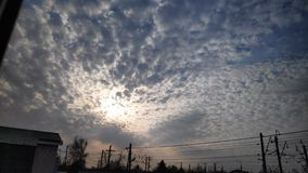 Video clip showing the movement of cirrus clouds and sunlight behind the clouds in the evening sky in time lapse mode.  stock footage