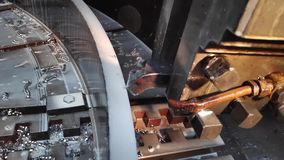 Video clip showing the work of a software-controlled machine close-up a coolant cutter in slow motion mode.  stock video