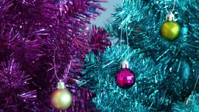 Colored tree and ornaments. Video of colored tree and ornaments stock footage