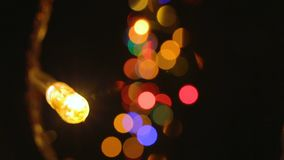 Video of colour lights and bokeh effect. Footage of colour lights with bokeh effect on black background stock video