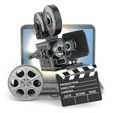 Video concept. Camera on  laptop, still reels and clapboard. Royalty Free Stock Photos
