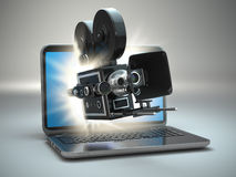 Video concept. Retro camera and  laptop. Royalty Free Stock Image