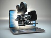 Video concept. Retro camera and laptop. stock illustration
