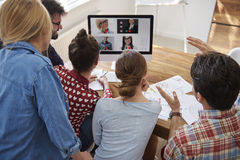 Video conference. With coworkers from abroad Royalty Free Stock Images