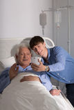 Video conference online. Older sick men and his grandson and video conference online Stock Images
