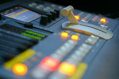 Video control console. Close up of digital video mixer (focus in the back Royalty Free Stock Images